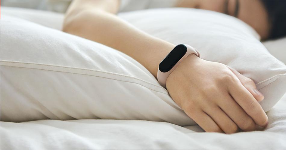 sleeping women wearing MI Band 4